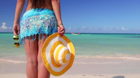 saona : Carefree young woman relaxing on Punta Cana beach. Caribbean vacation. Dominican Republic Stock Footage