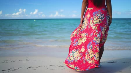 saona : Happy woman in tropical dress enjoys her summer vacation in the Caribbean islands