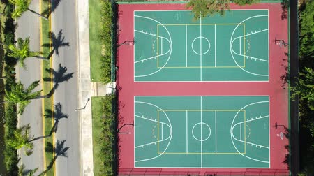 tennis stadium : Aerial Top View over playground with tennis, basketball and volleyball court in tropical resort Stock Footage