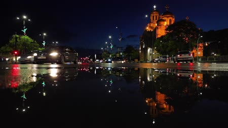 iluminado pelo sol : Night life in Varna city, Bulgaria. Downtown and the Cathedral of assumption Vídeos