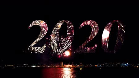 water show : Happy new year 2020, Fireworks sparkling in the night sky, celebration concert, holidays