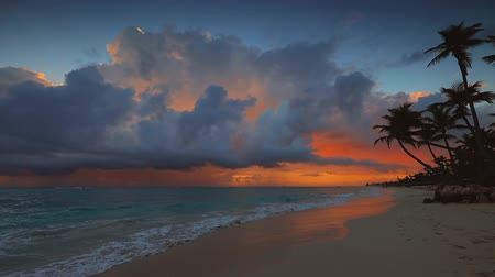 Beautiful cloudscape over the sea waves. Sunrise and tropical beach