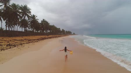 Carefree woman relaxing on tropical beach. Freedom and exotic island.
