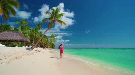 saona : Happy girl enjoying tropical sandy beach, Punta Cana, Dominican Republic Stock Footage