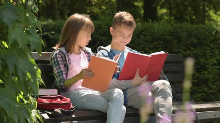 bank : Boy and girl reading book