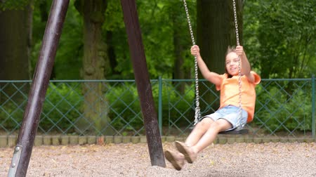 outside : Girl on chain swings