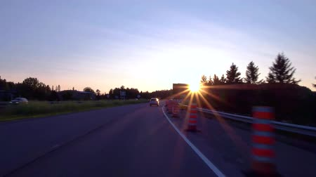 asfalt : Driving through roadworks on the highway at sunset, with perfect blue sky in the background