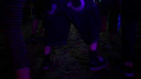 племенной : Feet of people dancing with shooes or barefeet on electronic music at night during a summertime festival (package of 6 scenes)