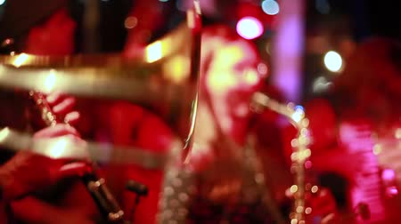 playing band : Close ups of musicians playing acoustic folk music on stage in a bar (package of 5 stages including guitar, trombone and violin) Stock Footage