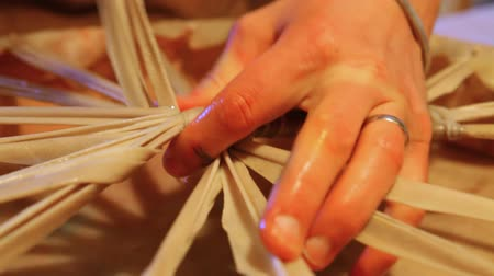 shaman : Hands of an artisan making sacred drum. Old-fashioned practices are used to create a ceremonial drum used for spiritual healing and shamanism. Closeup view as artisan finishes the membrane stretching