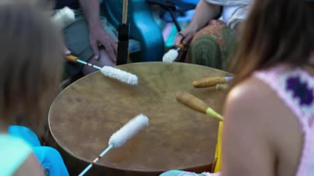 membrane : Sacred drums at spiritual singing group. People are seen beating a mother drum with long drumsticks during a celebration of indigenous and shamanic music, seeking mindfulness and spirituality. Stock Footage