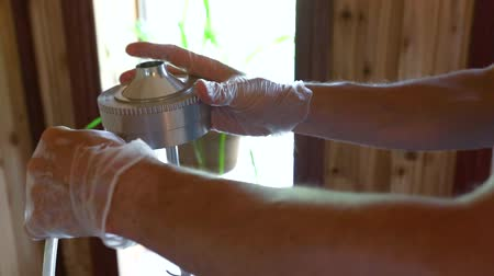 iaq : Indoor damp & air quality (IAQ) testing. Hands of a residential living quality inspector are seen in slow-mo and closeup, setting up an impactor and electronic equipment inside a domestic dwelling.