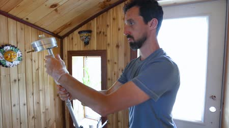 impactor : Indoor damp & air quality (IAQ) testing. A closeup video shot in slow motion of a building inspector preparing for the assessment of air quality inside a domestic home, placing impactor in family room.