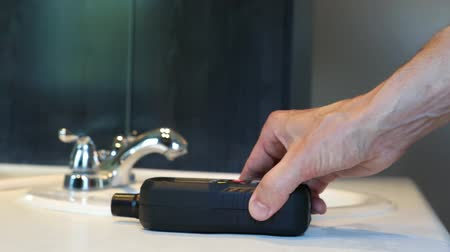 iaq : The arm of an indoor environmental quality tester is seen up close as he uses a handheld machine during the inspection of a domestic dwelling.