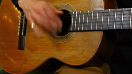 Travelling up on a professional guitarist practicing rasgueado or rasguedo flamenco strumming techniques at home Stock Footage