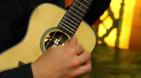 flamenco : Travelling up of a professional ukulele player with long hair practicing at home Stock Footage
