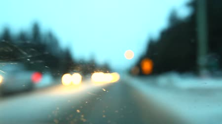 hız göstergesi : Poor visibility driving in the winter. Blurry and shaky scene simulating the effects of drunken driving. Lights going out of focus Stok Video