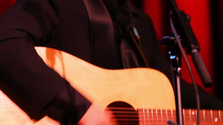 staging : Closeup footage of guitar players performing a set on a stage inside music bar. Details on stage as instrumentalists play rhythm and blues music.