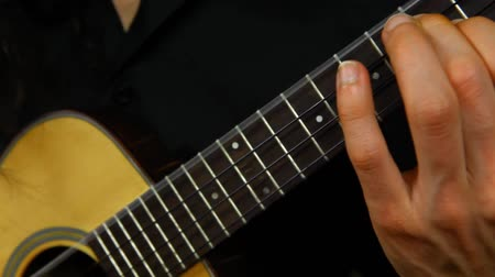 flamenco : Panning left of a professional ukulele player with long hair practicing fingerpicking techniques at home Stock Footage