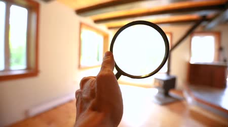 rothadás : Point of view during the assessment of a domestic dwelling, using a magnification glass to seek out defects and potential problems inside empty house. Stock mozgókép