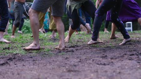 divinity : People are seen embracing freedom and spirituality as they dance barefooted on sacred ground during a celebration of native and traditional cultures. Stock Footage