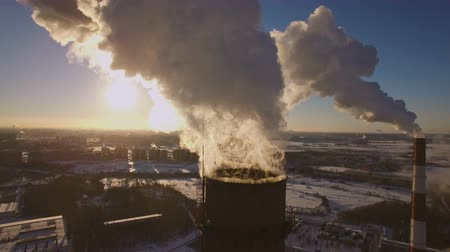 elektrownia : Smoking chimneys power station on sunset background in the winter. Aerial view