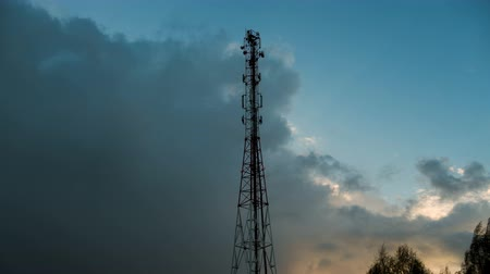 telecoms : Antenna telecommunications tower on the background of the coming storm Stock Footage