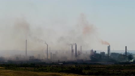 refining : Industrial landscape. From pipe factory smoke, polluting the atmosphere