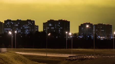 Modern residential buildings near the road junction. Timelapse