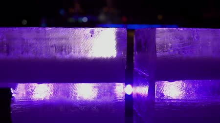 sculptures of ice in the rays of blue light at night