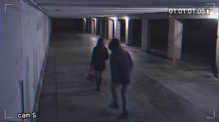 robbing a girl in an underpass. Recording from a surveillance camera Stock Footage