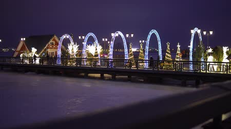 pier on a frozen lake decorated with New Years decorations in the city of Kazan Dostupné videozáznamy