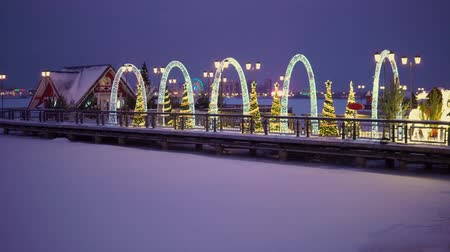 pier on a frozen lake decorated with New Years decorations in the city of Kazan Stock Footage