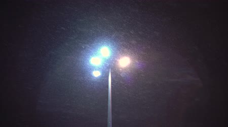 Snow falling in the light of a lantern Stock Footage