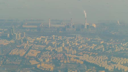 Air pollution by smoke coming out of two factory chimneys. Industrial zone in the city Stock Footage
