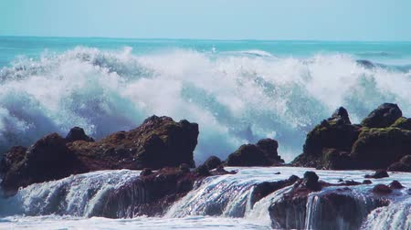 переполох : Wall of water and turbulent waves of Pacific ocean and rugged beauty of basalt rocks reef and cay cavity