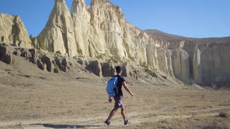 scout : a young traveler walks along a path in a mountainous area Stock Footage