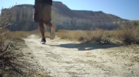крупный план : Runner feet running on road closeup on shoe. Slow motion