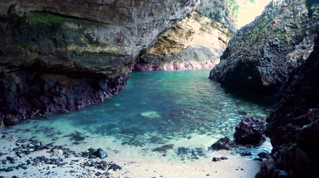 безмятежность : a view from the inside of a beach cave looking out at the sea. Bali, Indonesia Стоковые видеозаписи