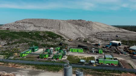 dumping : Community Solid Waste Landfill and Sanitary Landfill. Aerial from flying drone Stock Footage