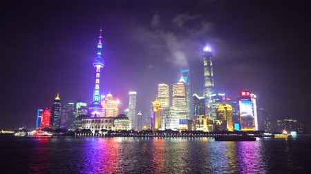 Night view of downtown Shanghai called the Bund, located on the embankment of the river Huangpu Stock Footage