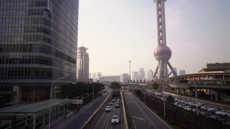 pudong : Skyscrapers of the Pudong area with Oriental Pearl Tower and road with cars. Shanghai, China