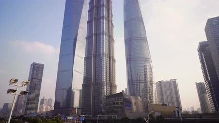 штаб квартира : Skyscrapers of the Pudong area with shops, malls and road with cars. Shanghai, China Стоковые видеозаписи