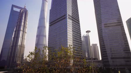 штаб квартира : Skyscrapers of the Pudong area against the blue sky, Shanghai, China Стоковые видеозаписи