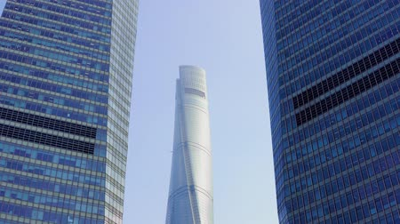 pudong : two skyscrapers between which the third one is visible against the blue sky in the Pudong area, Shanghai, China Stock Footage