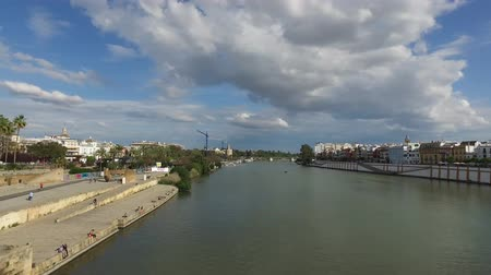 levee : Seville, Andalucia, Spain - April 18, 2016: Bridge of Isabel II city of Seville, Spain (Ultra High Definition, UltraHD, Ultra HD, UHD, 4K, 2160P, 3840x2160) Stock Footage
