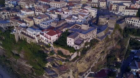 оттенки : Aerial view of Pizzo Calabro, pier, Calabria, tourism Italy. Panoramic view of the small town of Pizzo Calabro by the sea. Houses on the rock.