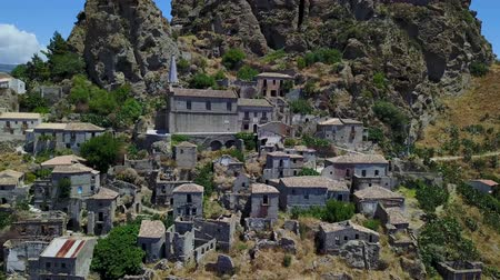 salvo : Aerial view of the village of Pentedattilo, church and ruins of the abandoned village, Greek colony on Mount Calvario, whose form recalls the five fingers, the name of the village derives from the Greek Stock Footage