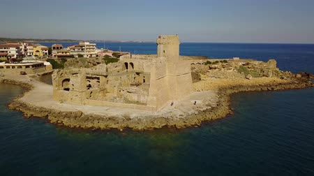 Aerial view of the Aragonese castle of Le Castella, Le Castella, Calabria, Italy: the Ionian Sea, built on a small strip of land overlooking the Saracens Coast in the hamlet of Isola Capo Rizzuto Wideo