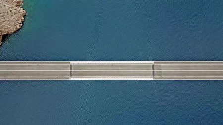reinforced concrete : Aerial view of the bridge of the island of Pag, Croatia, road. Cliff overlooking the sea. Cars crossing the bridge seen from above